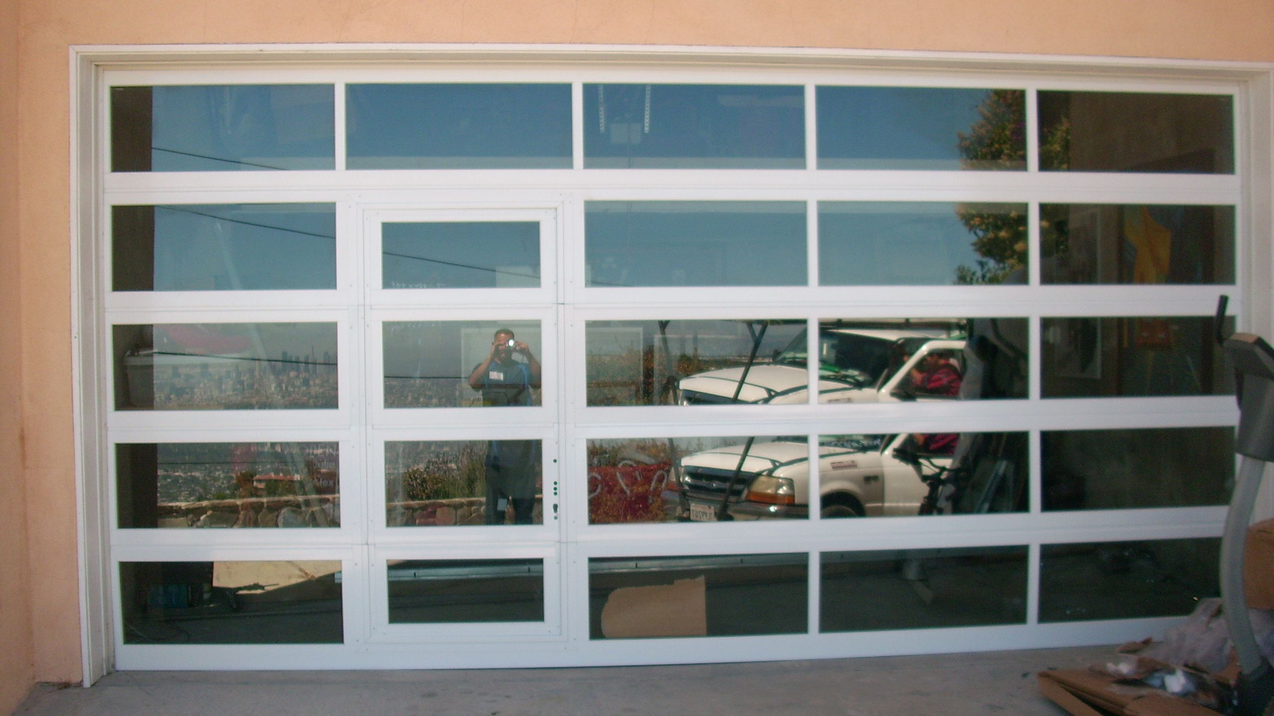 Clear Glass Garage Door With Passage Door Front View