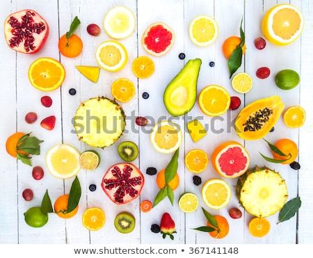 Mix Of Colored Fruits On White Wooden Background