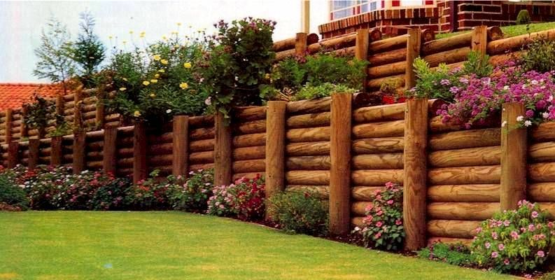Timber log retaining walls GopherHaul Landscaping Lawn Care