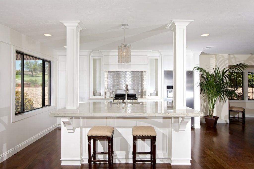 Kitchen Island With Columns transitional kitchen with kitchen island, high ceiling, breakfast
