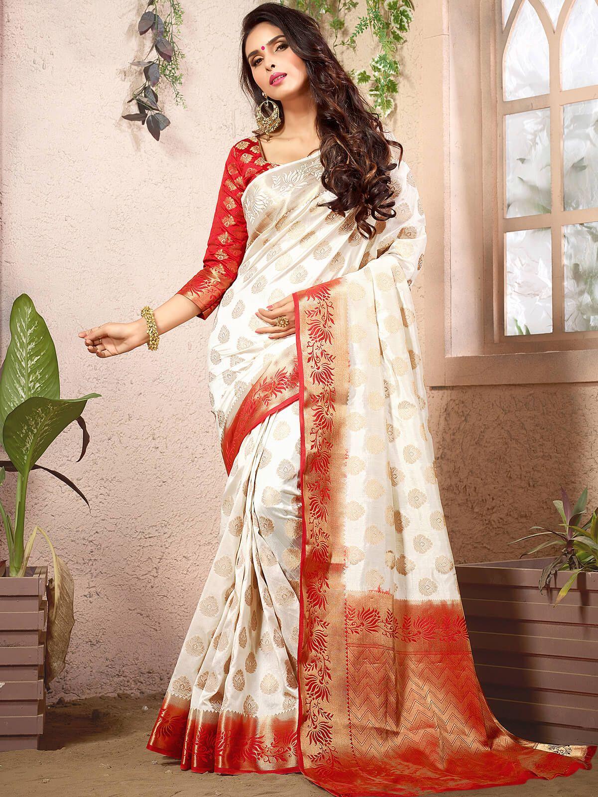 Spirited white and orange party wear silk designer woven saree