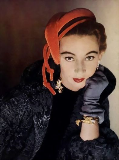 Sophie Malgat wearing a hat by Gibert Orcel and jewellery by Boucheron, 1952.