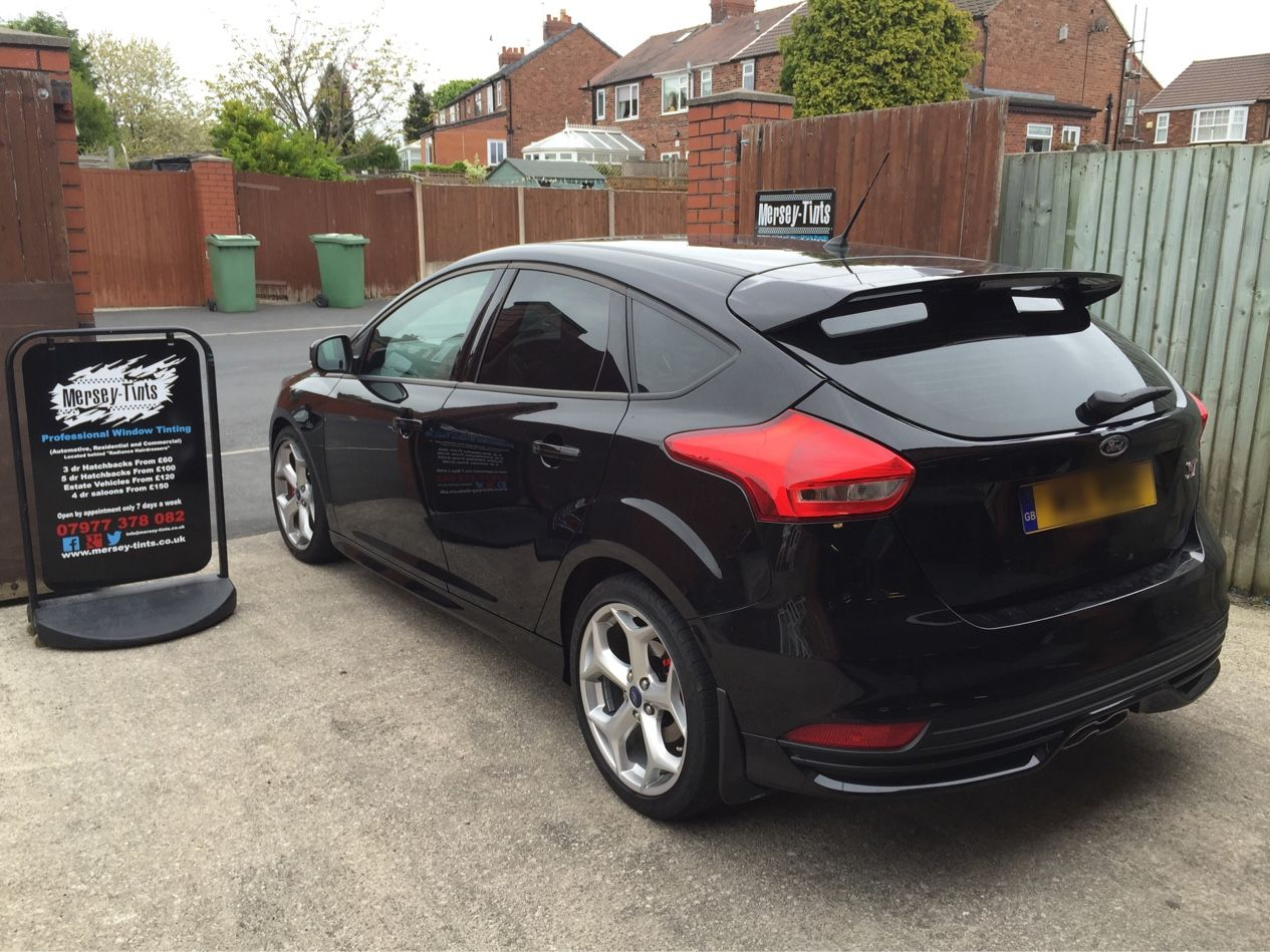 2015 Ford Focus ST in this morning for 18% Carbon tints to the rear