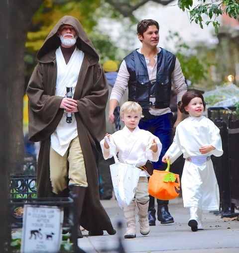 Obi-Wan Kenobi and Han Solo, with their kids dressed as Luke Skywalker and Princess Leia