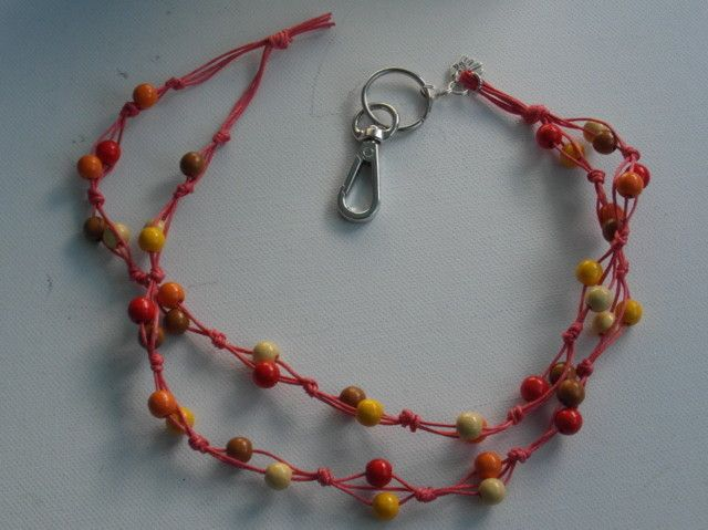 Avainnauha #12 by Miss Piggy / Key chain, ID holder. Made with wooden beads and waxed cord.