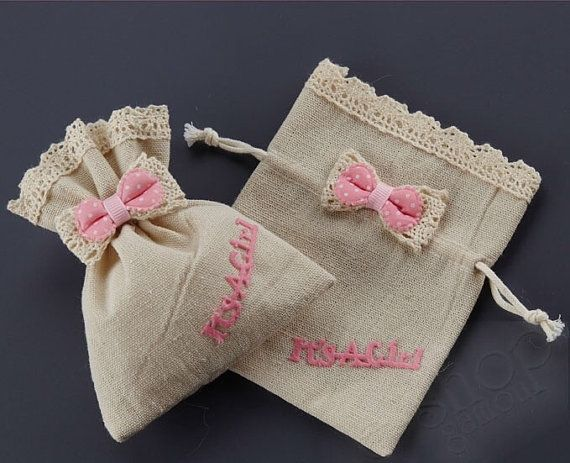 50 empty, cute linen and lace drawstring favor bags with bow for you to fill with anything you like:sweets, lavender etc. Wonderful for baby