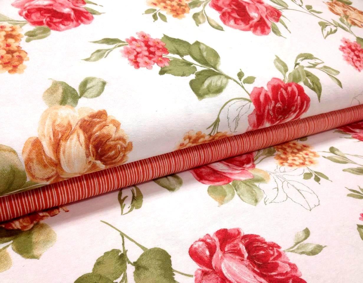 5d0222b64970 BAVLNENÝ ĽAN RUŽE . Oranžové + červené ružičky na bielom podklade .  Štruktúra látky - ľan