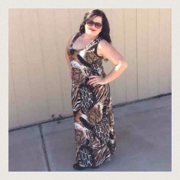 """Listing Animal Print Razor Back Maxi Adorable maxi with sparkles all over the front and back. Model is wearing a 1X. 57"""" long. 1X-PTP 20.5"""", 2X- 21"""", 3x- 22"""". 95% poly, 5% spandex. Pair with some cute sandals and a floppy hat.  Be the hit of the party. MT Collection Dresses Maxi"""