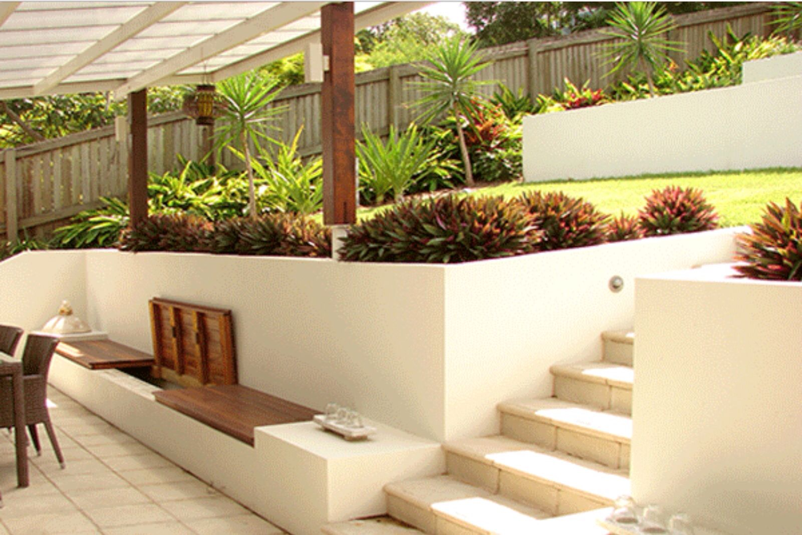 Retaining walls steps and built in seating storage for Retaining wall design ideas