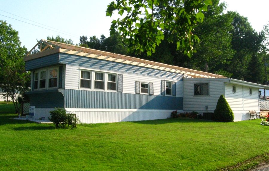 Conneaut Lake Area Mobile Home Has A Roof Built Over It