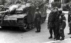 Operation Market Garden: Captured British soldiers walk past a German self-propelled gun StuG III in Arnhem, 1944.