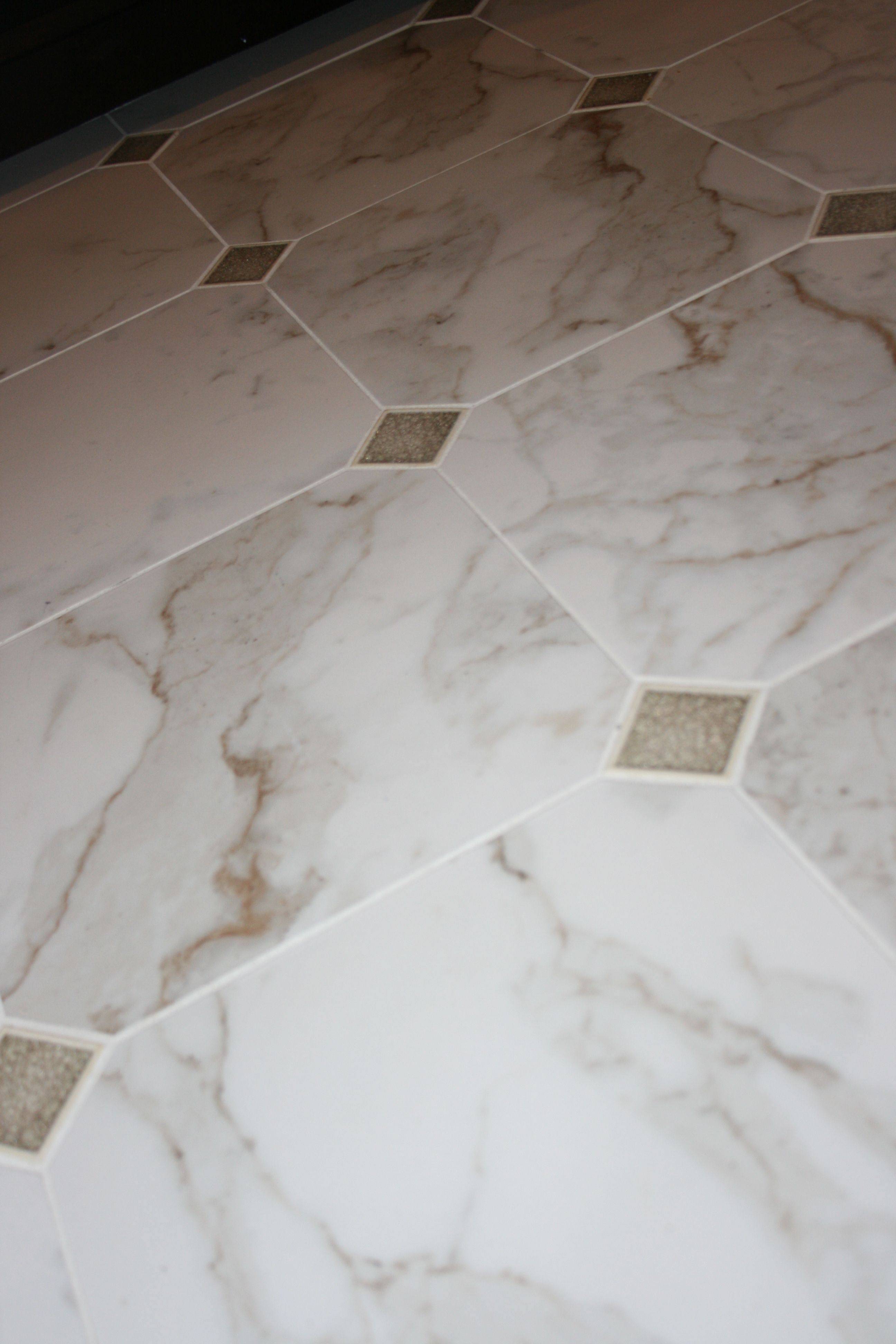 An Amazing Calacatta Knock Off Yes It S Porcelain With Some Encore Ceramic Jewel 2x2 S Clipped In Floor Tile Design Ceramic Floor Tile Glass Tile Design