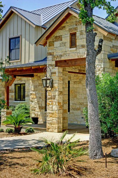 Hill Country Barn Buiding With Tan Metal Siding And Timber