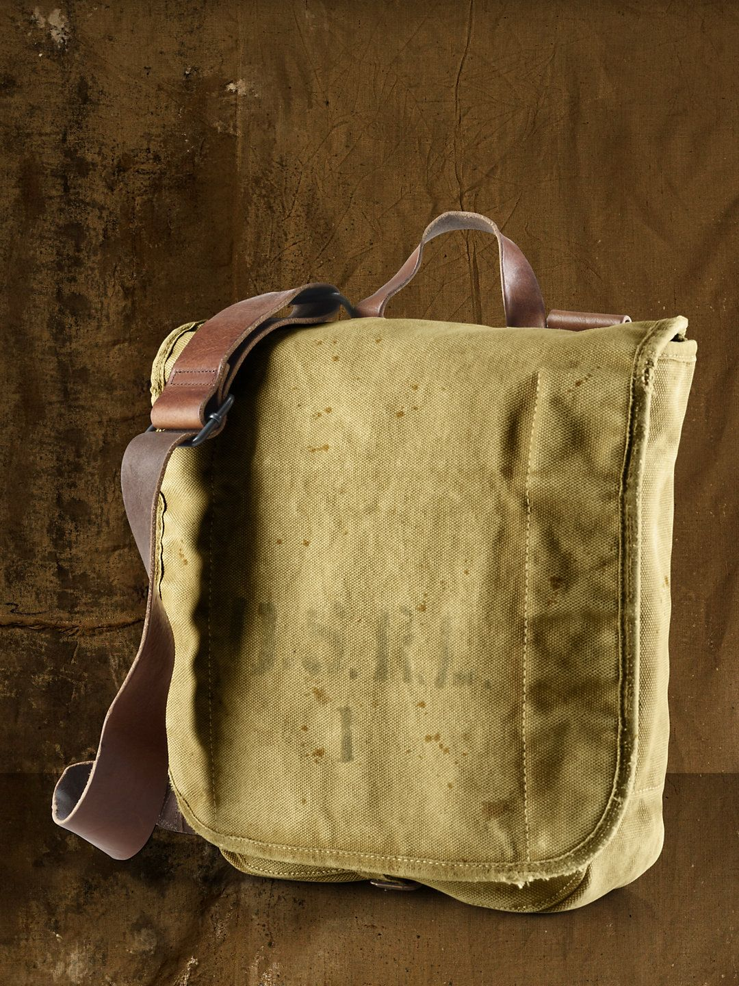 d3d9de197049 Ralph Lauren Canvas Messenger Bag military inspired Canvas Messenger Bag is  built to last with a durable broken-in body and rugged leather details. Sale  ...