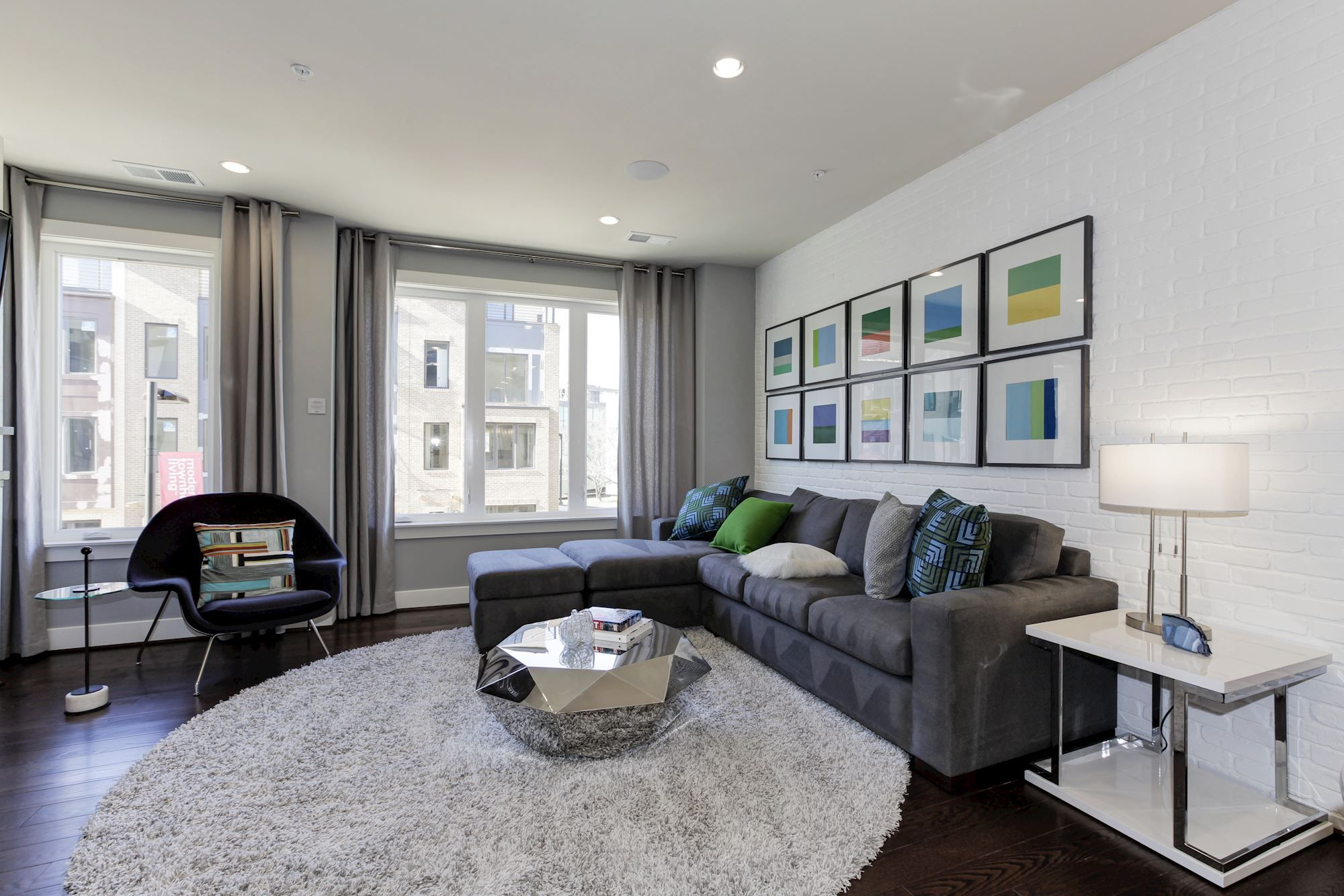 Sample Modern Blue And Gray Living Room With Glass Geometric Focal Table In Our Daniel Model At Montgo Living Room Grey Luxury Townhomes Interior Design Styles #sample #of #living #room #design