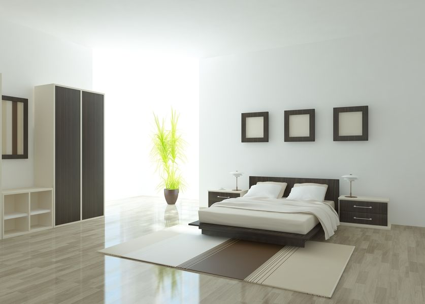 simple wood and white master bedroom with wood bed frame floating side tables and