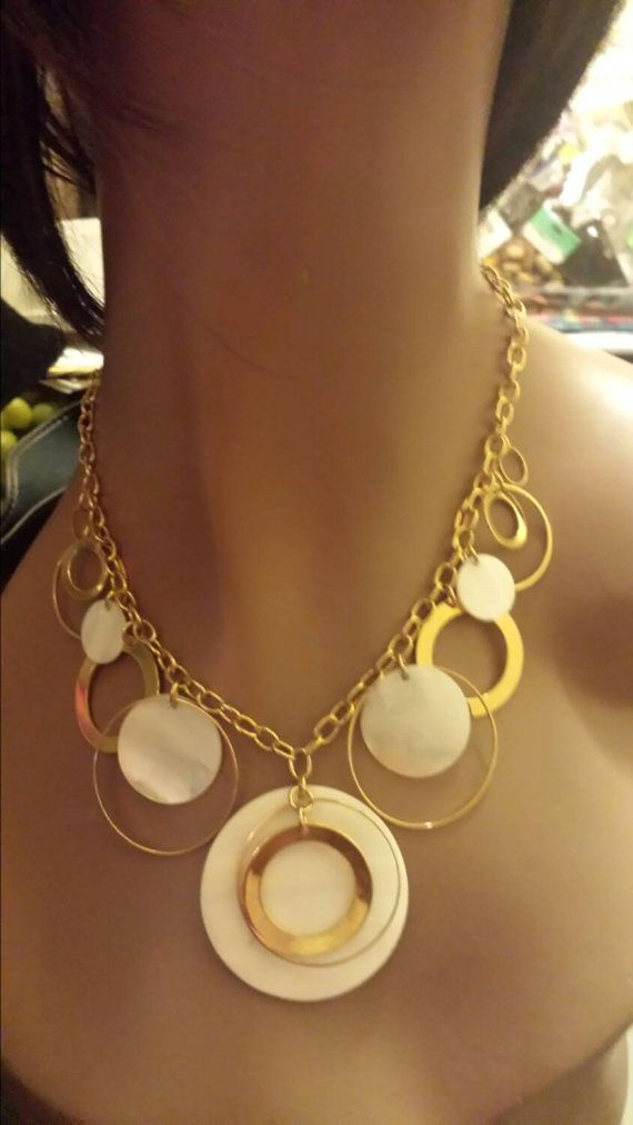 Lovely mother of pearl necklace  https://www.etsy.com/listing/210476597/mother-of-pearl-rings-necklace