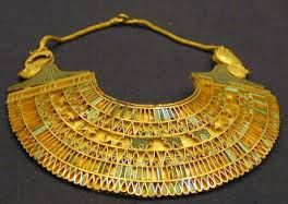 Ancient Egyptian gold jewelry artifact exhibit in the Egyptian