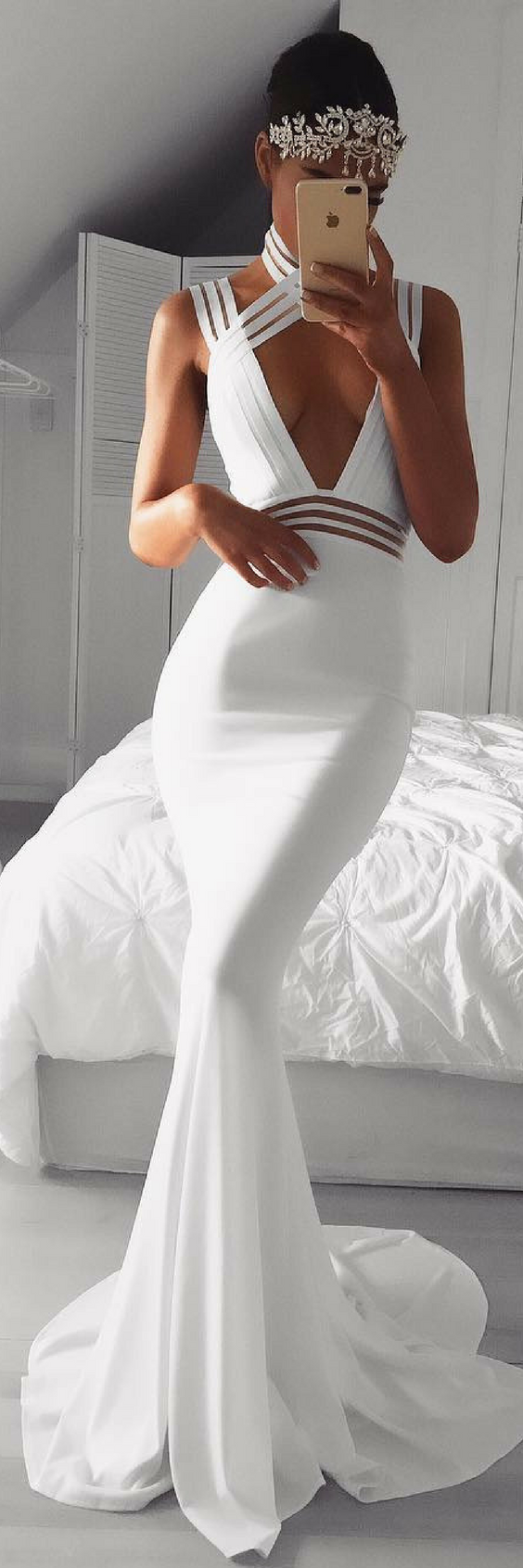 Maybe too revealing for a wedding gown, but it's beautiful ...
