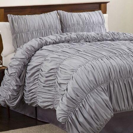Lined with elegantly tailored ruching, this glamorous silver comforter set outfits your mater suite or guest room in inviting texture.