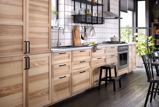A Kitchen With Natural Ash Doors And