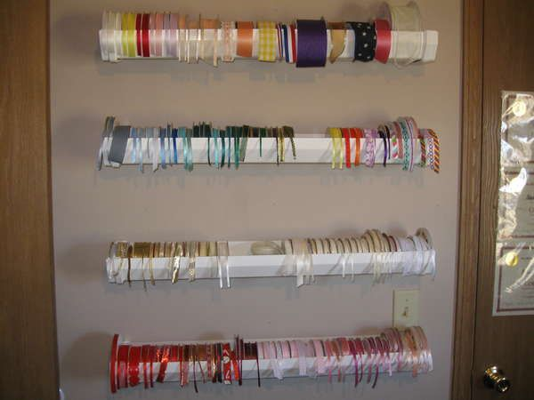 Great idea to hold ribbons.  Vinyl rain gutters.  Only $5.83 for 10 ft. at Home Depot!
