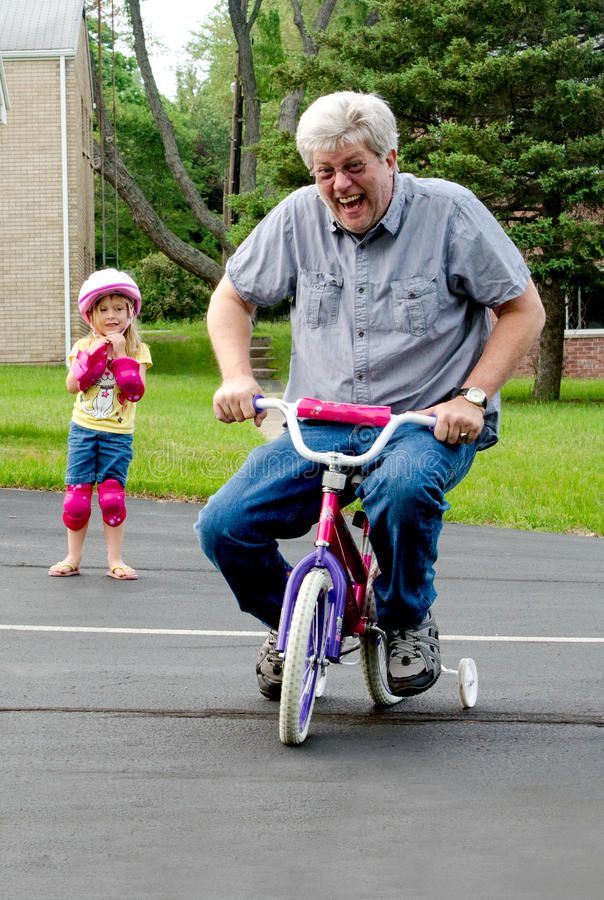 Learning To Ride A Bike With Training Wheels An Older Man Takes