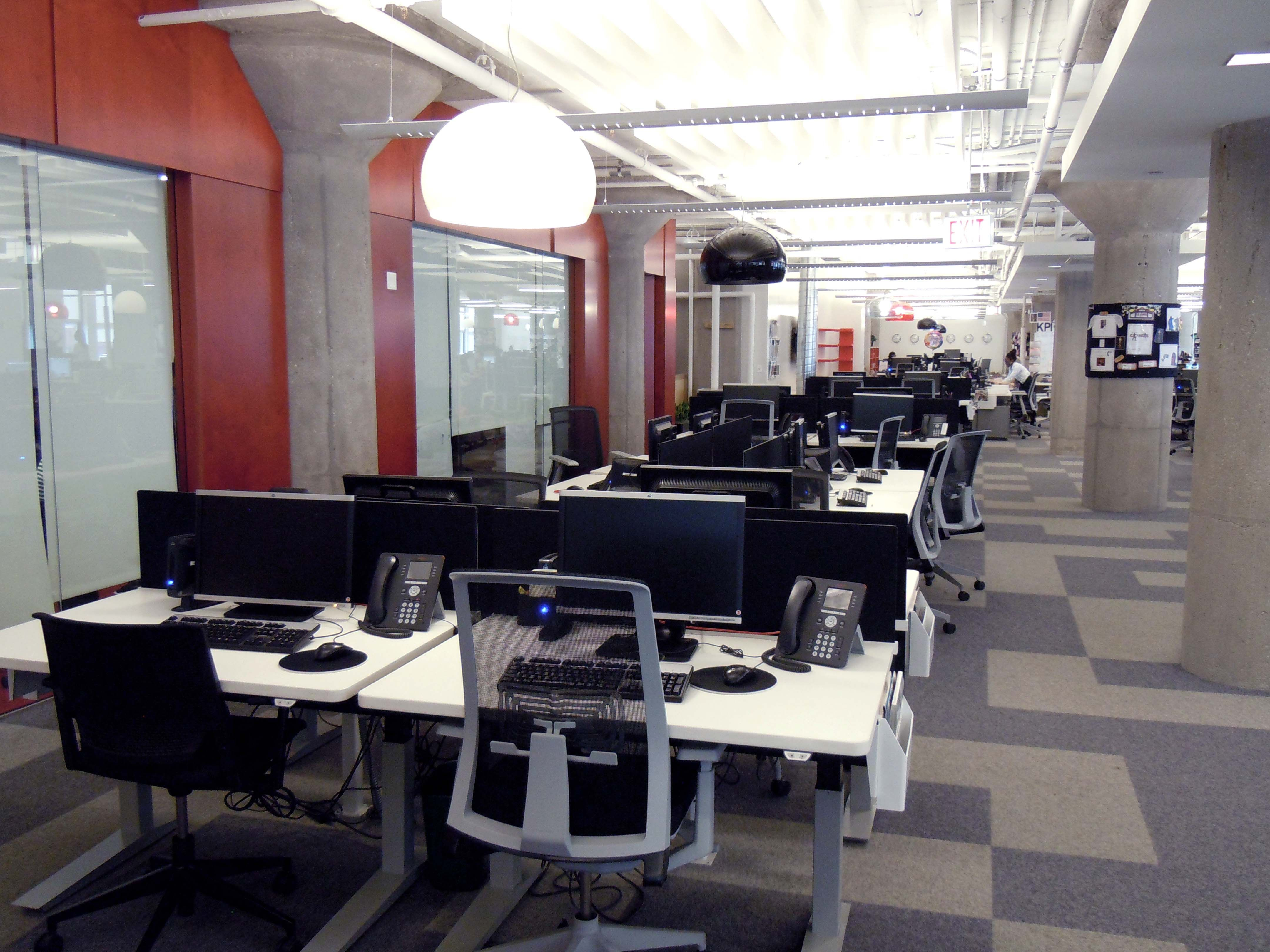 Open plan office with stand up desks.