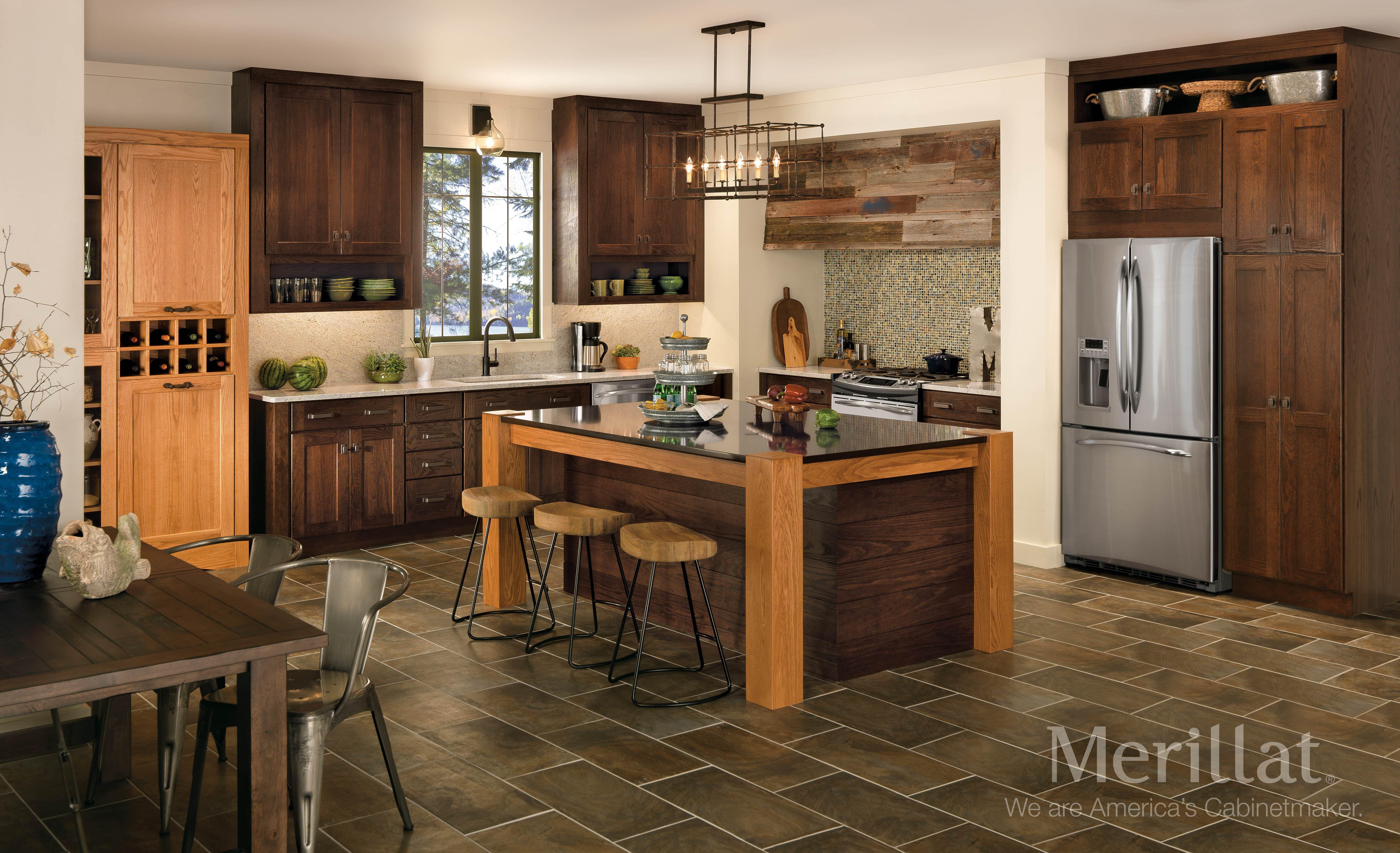 Merillat Classic Tolani Oak Pecan And Hazelnut Merillat Cabinetry Incorporate Metal Hardw Kitchen Cabinet Design Kitchen Design Merillat Kitchen Cabinets