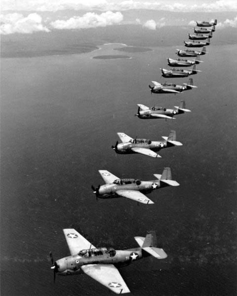 TBF-1 Avengers Torpedo Squadron 10 of the USS Enterprise flying in formation on Espiritu Santo, March 1943