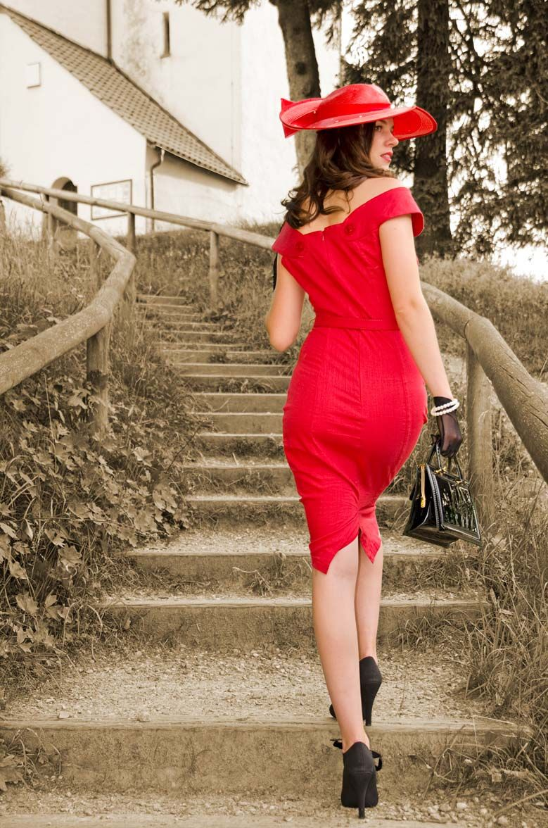 RetroCat wearing a red vintage inspired wiggle dress