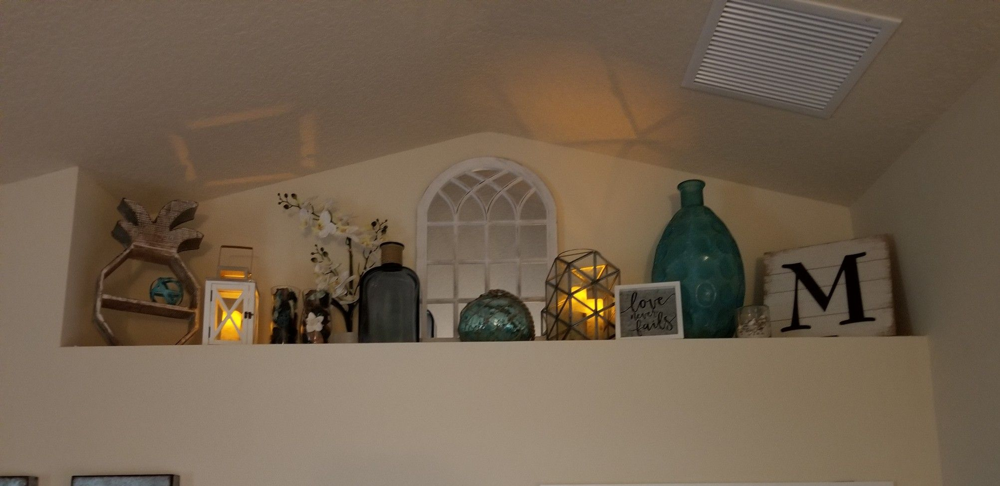 The Bishop S Our Home A Little Preview Shelf Decor Living Room Vaulted Ceiling Living Room Ceiling Shelves