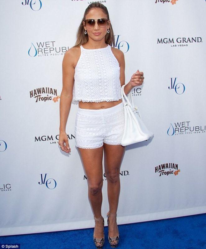 134d7f07094 Jennifer Lopez wearing Lanvin Snake-print Canvas Wedge Sandals Hermes  Birkin in White Bec   Bridge Bianco top Wet Republic Ultra Pool at The.