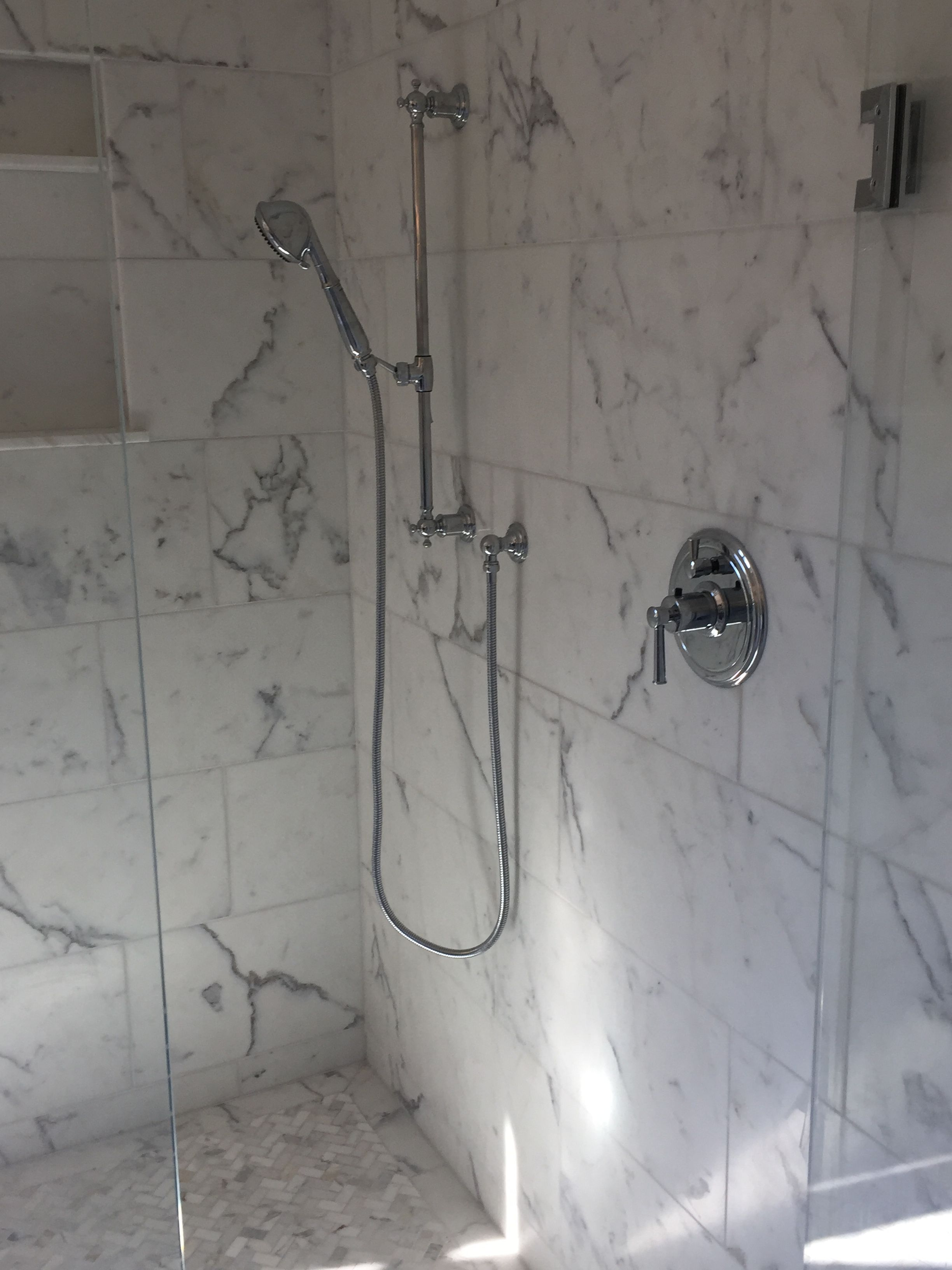 Keeping Interiors Calacatta marble and mini calcatta herringbone