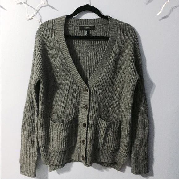 c94db7e32cca6 Knit grey cardigan Buttoned down cardigan with pockets. Very cozy and  slight baggy fit