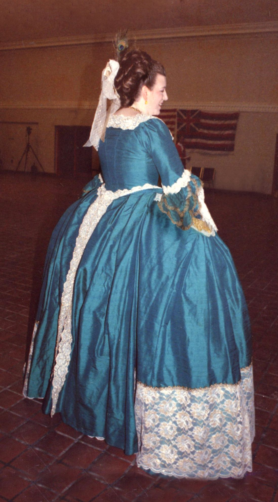 The 'mantua' has the same construction and back 'tails'-somewhat deflated during an evening of 18th century dancing. Just barely visible are the petticoat side 'rosettes' at the terminus of the pocket slits. Years ago, Janet Arnold created a gridded pattern of this outfit; I'm lucky enough to have a copy of it, which was the basis of this ensemble.