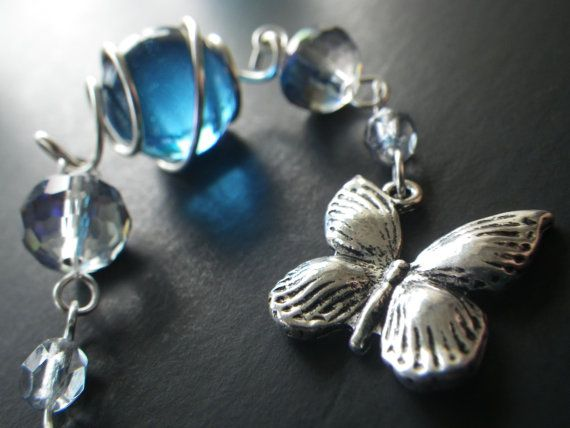 This rear view mirror charm has a lovely silver butterfly charm that hangs from a beautiful handcrafted chain with blue glass beads. This rear view