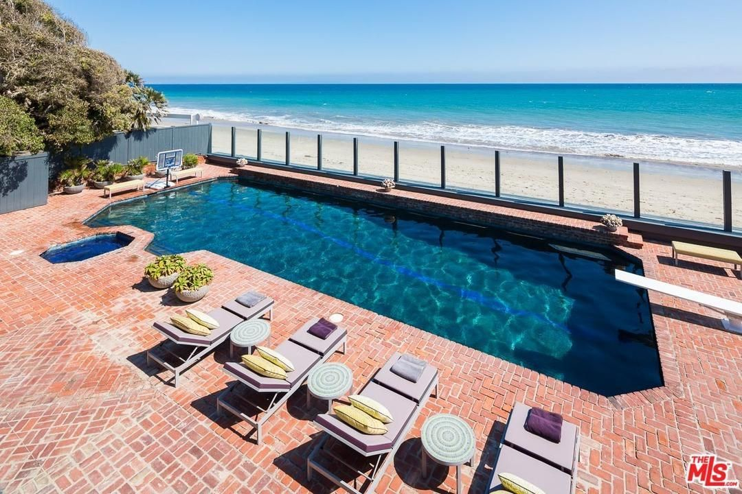 Extremely generous patios extend to the pool, spa and tennis court - perfect for entertaining.