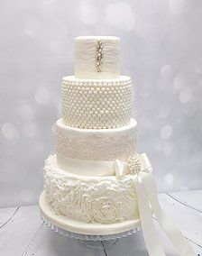 Four Tier Elegant Wedding Cake By Southwell Cakery Nottinghamshire Maker Decorated With Sugar Ruffles Silver Dragees Edible Pearls And Lace