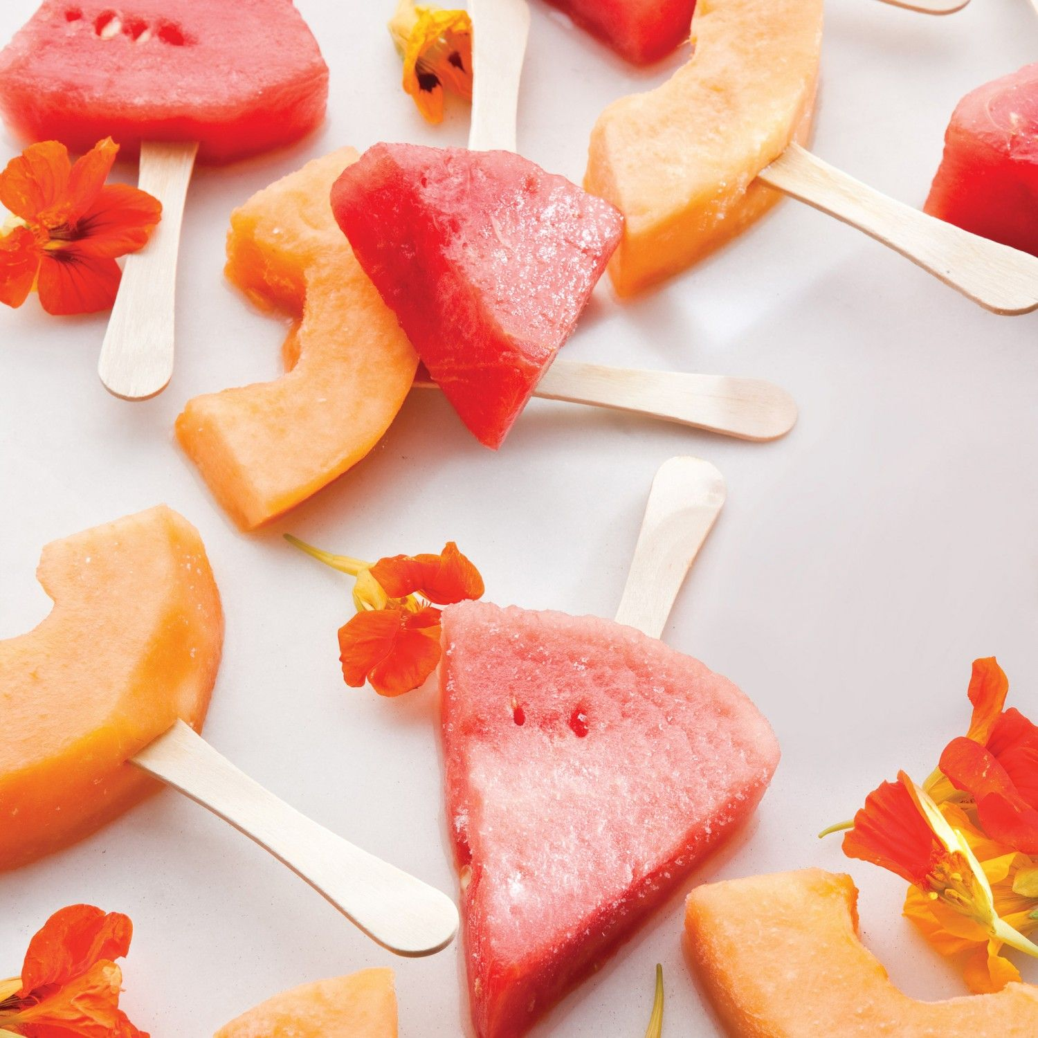 These frozen melon-margarita pops are tangy hand-held treats that make you feel grown-up and kidlike at the same time. Dip juicy pieces of melons in…