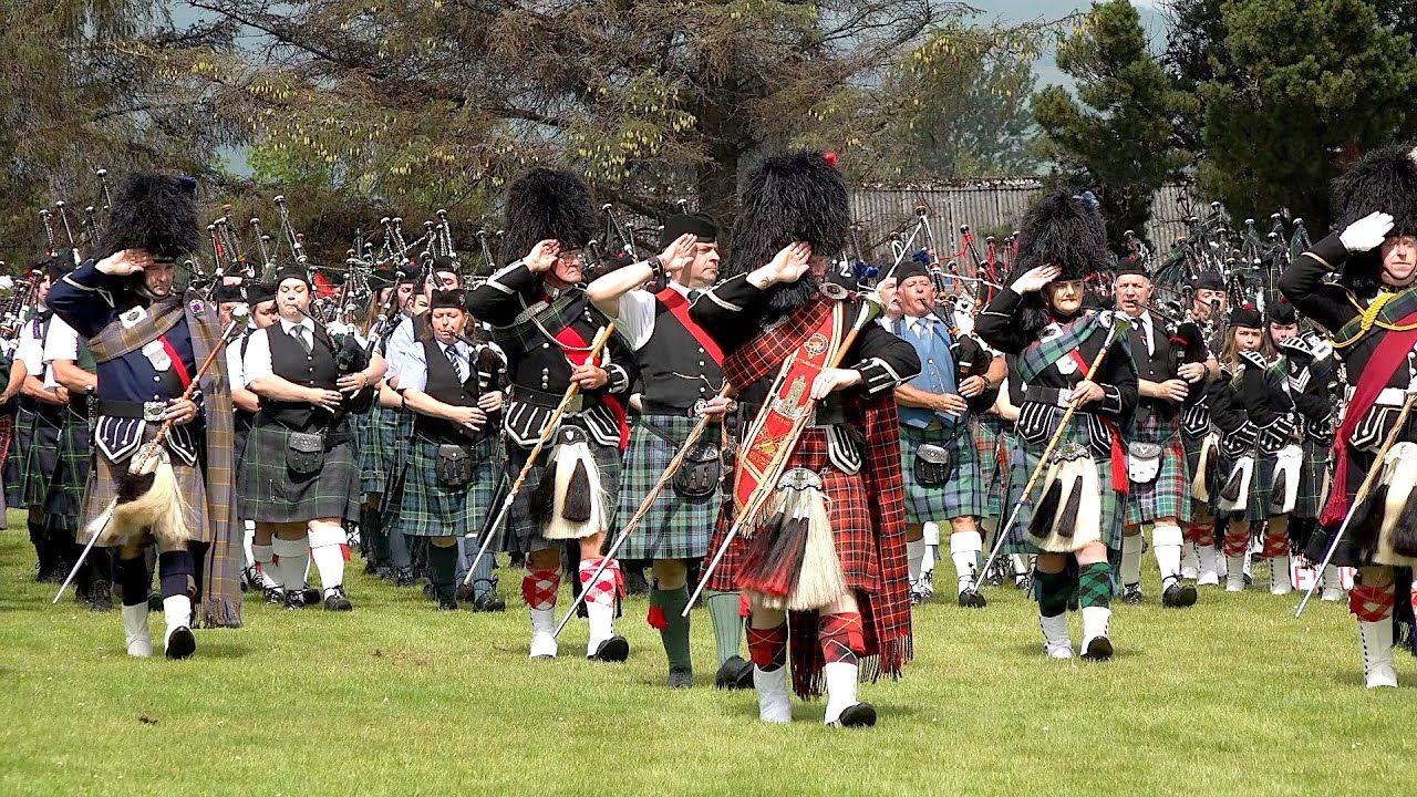 Massed Pipes & Drums parade to start the 2019 Dufftown