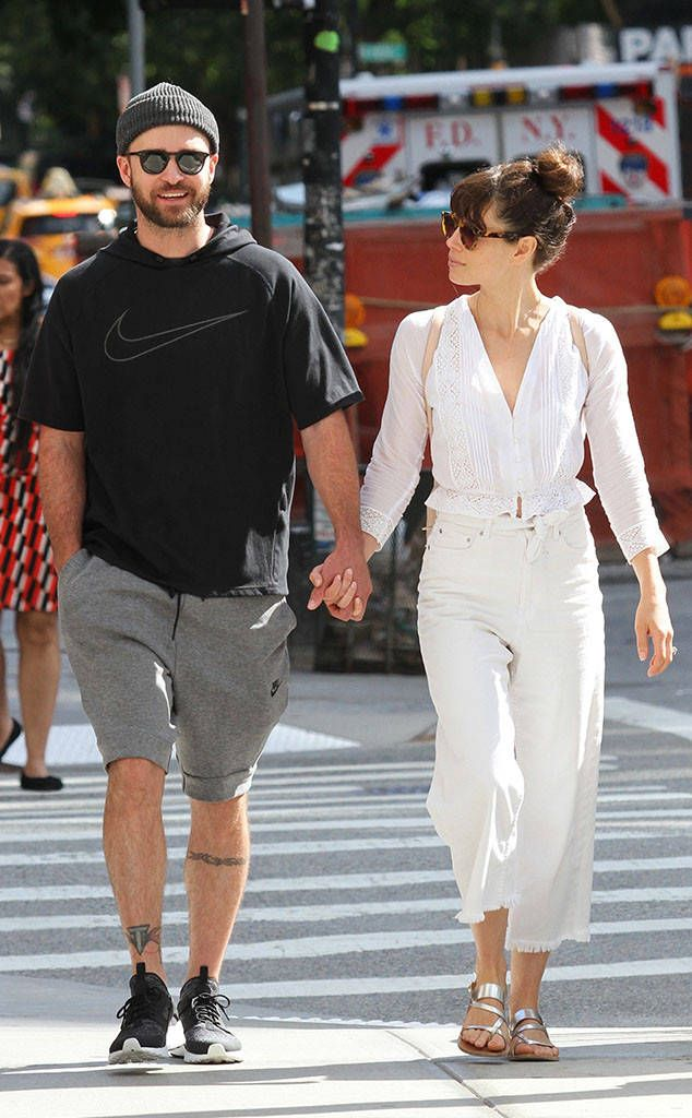 a501895b1934 Cute couple Justin Timberlake   Jessica Biel walk hand-in-hand while  donning chic shades.