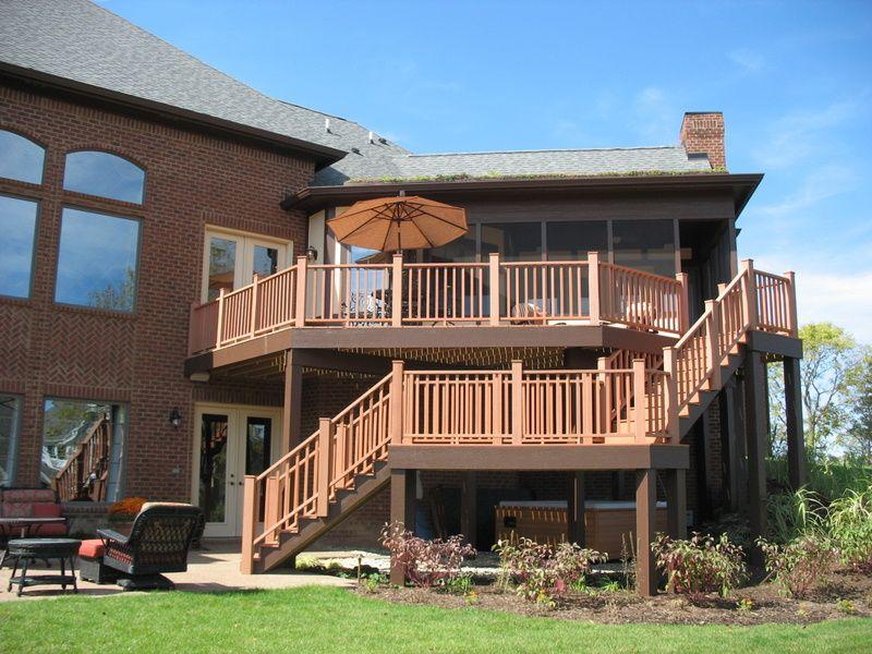 Home a rama house 2 environmentally friendly tudor for Deck designs over walkout basement