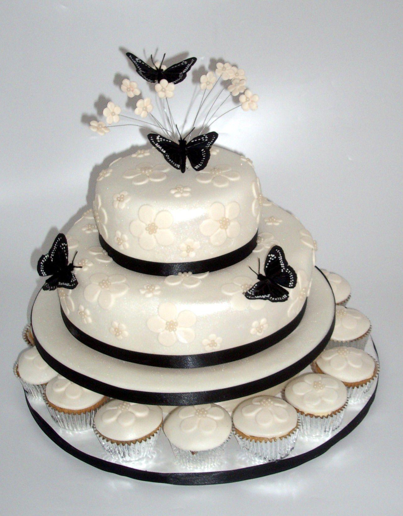 Flowers u butterflies wedding cake make the black into blue the