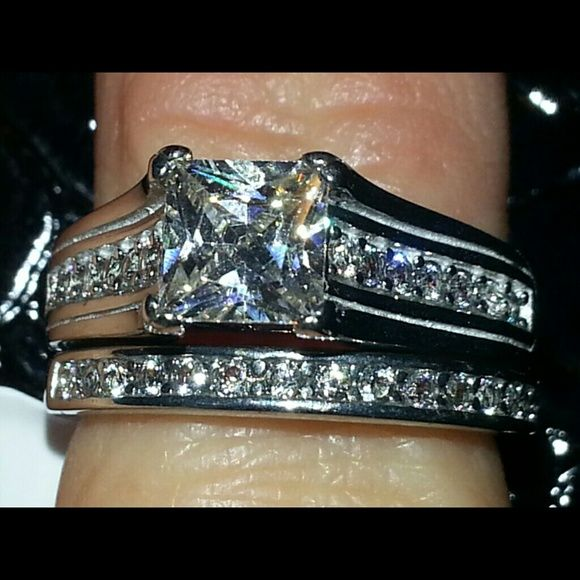 NWT Cathedral Princess Cut CZ Wedding Set Size 7 Cut to look identical to a real diamond!!!! Absolutely stunning and elegant.  My ring next to it is a $4500 set, and you can see it looks just as gorgeous. 316 so no coloring on your finger. Jewelry