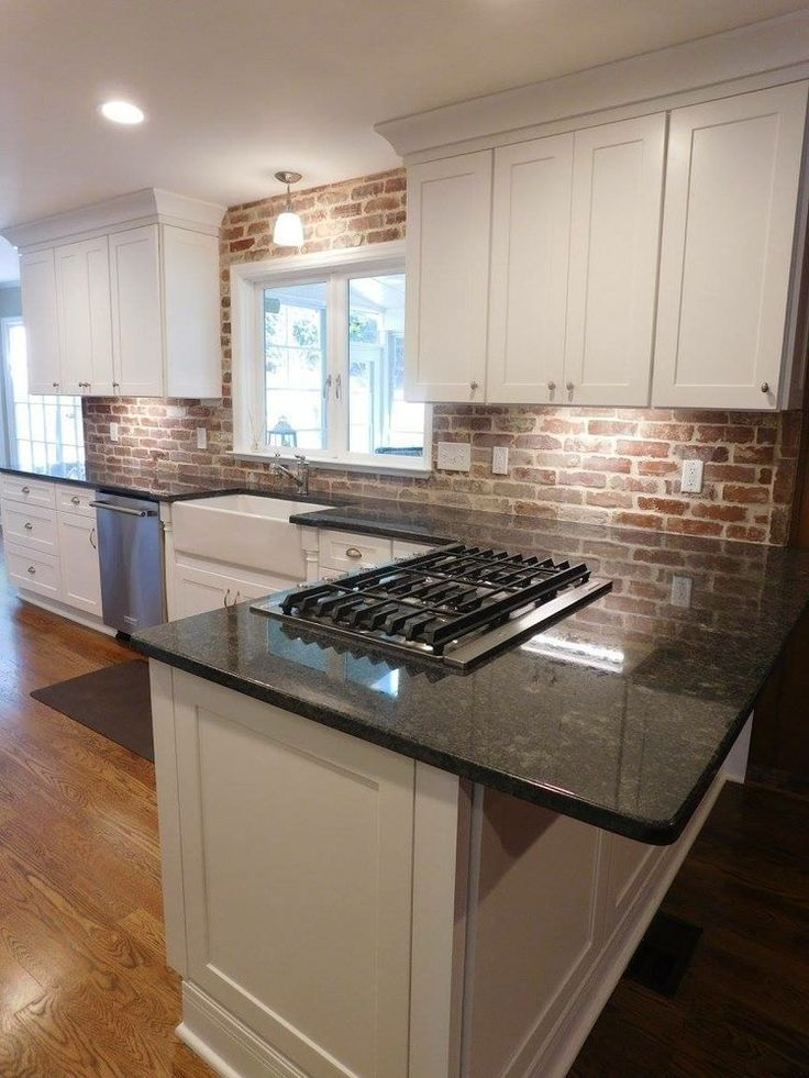 Brick Back Splashes Are So On Trend Brick Looks Stunning With White Cabinetry Achieve This Look With Our Fremont C Kitchen Design Home Kitchens Brick Kitchen