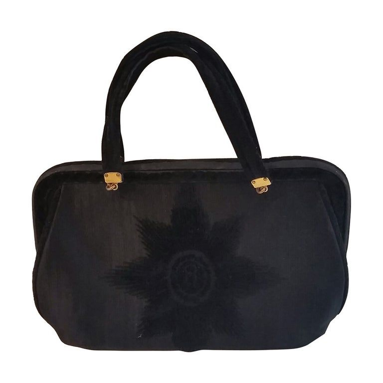 1960s Roberta di Camerino black bag in textile and velvet. Lining Red leather