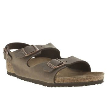 Birkenstock Brown Roma Unisex Junior Little feet can indulge in classic Birkenstock styling too, as the brand downsize their Roma sandal for kids. The brown man-made strappy upper features functional buckle fastenings for a secure and cu http://www.MightGet.com/january-2017-13/birkenstock-brown-roma-unisex-junior.asp