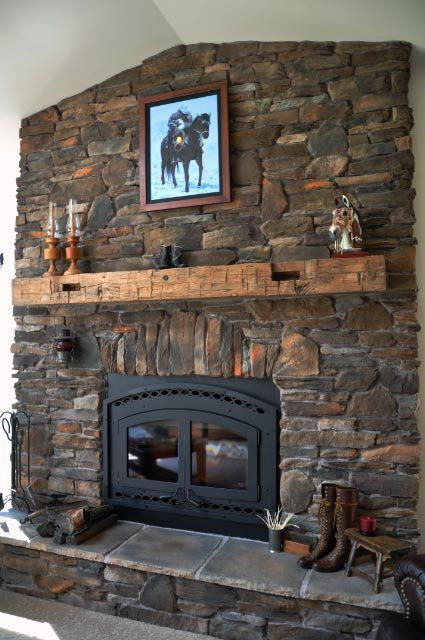 Antique hand hewn beams and original rough sawn are reclaimed from  old barns industrial Fireplace IdeasFireplace MantelsStone