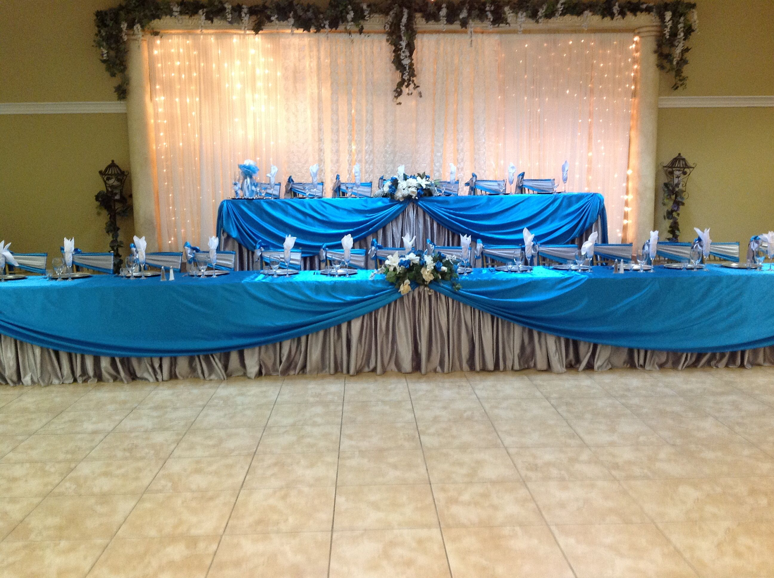 Main tables in turquoise and silver for a Quinceanera at Villa